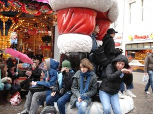 Sitting outside a very windy Christmas market in Köln, Germany.